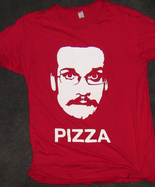 "Ah, my Pizza John shirt. An extensive vlogbrother's inside joke developed by nerdfighteria to indicate that John Green is fat and at one point had a creepy mustache. The easiest way to get weird looks in public or awkward questions such as ""So who is that, on your shirt?"" They never like ""Award Winning Author John Green"" as an answer for some reason. It was actually a gift from my girlfriend at the time. It was an excellent gift from a hella cool person. Third in the #shirtaday project"
