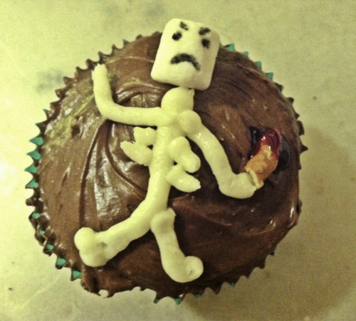 He is an angry cupcake.  Haha. I was just having fun with these. These have the candy corn center as shown earlier. :-)