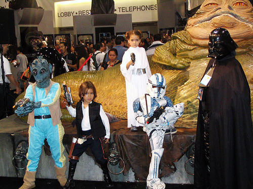 cosplayingchildren:  [Description: Child Han Solo is my hero right now, NGL. That hair, tho. Greedo, Han Solo, Leia, a Storm Trooper and Vader all pose on a giant Jabba the Hut.]