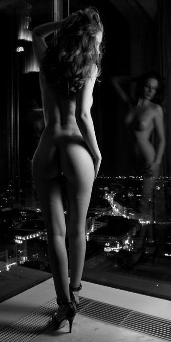 She's very skinny, but the cityscape below her is gorgeous.