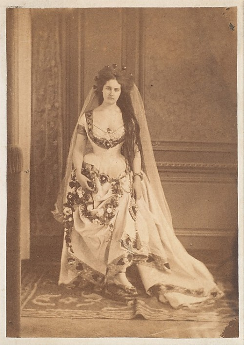 The Countess di Castiglione caused a scandal by appearing at a 1857 costume ball at the French Ministry of Foreign Affairs as The Queen of Hearts, a thinly veiled allusion to the fact the she was currently the mistress of the emperor, Napoleon III. She was photographed in the costume by Pierre-Louis Pierson several years later, between 1861 and 1863, apparently wishing to preserve the scandal for posterity.