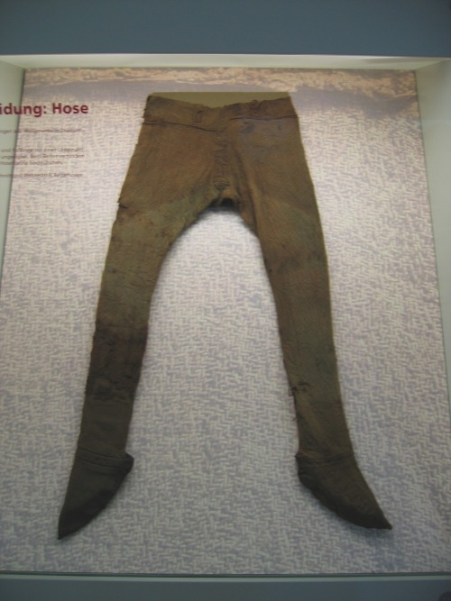 "Trousers with attached socks, ca 4th century Germany, Schleswig-Holsteinisches Landesmuseum Germanic and Celtic tribes wore leggings referred to as ""trousers"" that were initially looked down upon by the Greeks and Romans because they were worn by ""barbarian"" cultures.  Draped tunics were viewed as symbols of civilization, much like how we today might view a tuxedo vs overalls and no shirt.  Eventually, however, Romans in northern regions did adopt trousers for warmth.  They became accepted in part because trousers were also worn at the time by the Persians.  Loose trousers were worn under tunics in the Byzantine Empire.  The trousers in the picture above were found in the Thorsberg moor in Angeln, Germany. Just a side note: These were probably put in the moor by themselves as a votive offering, not with a body attached to them."