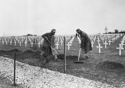 "One year after the D-Day landings in Normandy, German prisoners landscape the first U.S. cemetery at Saint-Laurent-sur-Mer, France, near ""Omaha"" Beach, on May 28, 1945. (AP Photo/Peter J. Carroll) #"