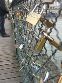 theamericanblondetraveler:  This is a bridge in Paris. You hang locks on it with the name of you & your boyfriend/girlfriend/best-friend then throw the key into the river. So even though the friend/relationship may end, you can't remove the lock. It stays there forever, as relevance to someone once a part of your life.
