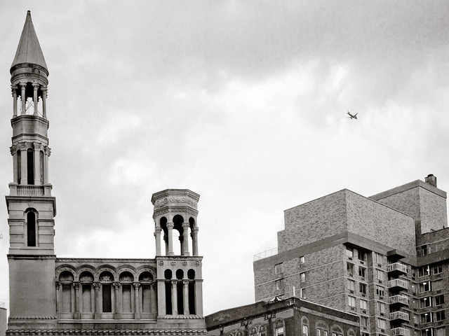 A Lil' Birdie on Flickr.A plane flies over Manhattan's Upper West Side