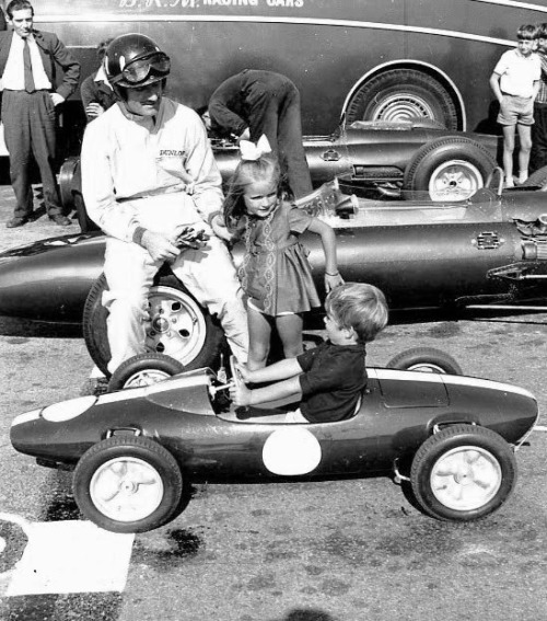 Graham Hill & Damon Hill, learning about the tools of the trade. Source