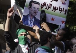 Syrians living in Egypt hit an illustration of  al- Assad with a shoe during a demonstration against Assad and his government, in front of the Syrian embassy in Cairo October 30, 2011. REUTERS