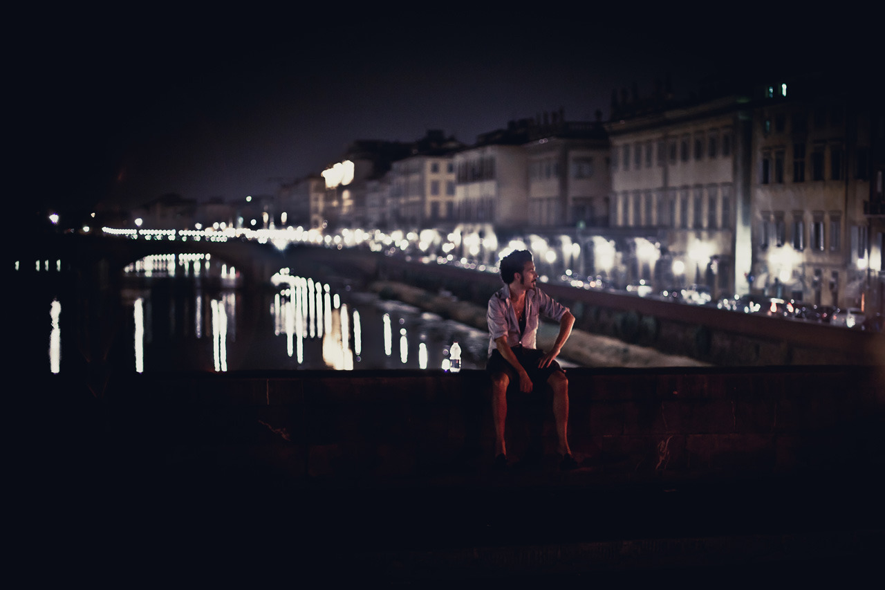 Guy on Bridge on Flickr. Guy having a rest on a bridge crossing the Arno in Florence during a warm summer night.