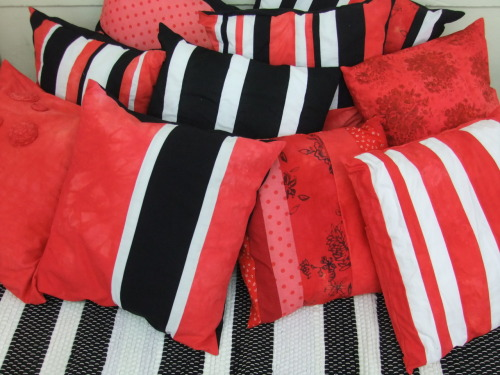 My range of cushions for my colour way Red/Black/White These are all handmade with recycled materials, the red has been achieved by over-dying the original fabrics