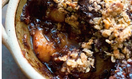 Pear and oat chocolate crumble Serves 4 ripe pears 850g lemon ½ butter 30g golden caster sugar 50g For the crumble: butter 50g plain flour 45g demerara sugar 45g jumbo oats 3 tbsp water or milk a couple of tbsps dark chocolate 80% cocoa 50g Peel the pears, rubbing them with lemon juice to stop them discolouring, then cut them in half and discard the stalks. Scoop out the core and pips with a teaspoon. Melt the butter over moderate heat. As it starts to sizzle, add the sugar and pears and let them colour lightly. As they soften, let the sugar caramelise here and there. Tip the pears and their juices into a 1.5-litre baking dish. Set the oven at 180C/gas mark 4. Make the crumble: rub the butter into the flour with your fingertips or use a food processor. When the mixture looks like coarse breadcrumbs, stir in the sugar and oats. Add a tbsp of water or milk and shake until it forms gravel-sized lumps. Chop the chocolate into small pieces then fold it through the crumble. Tip the mixture over the pears, leaving the surface quite rough. Bake for 40-45 minutes, until lightly coloured. (via Nigel Slater's chocolate recipes | Life and style | guardian.co.uk)