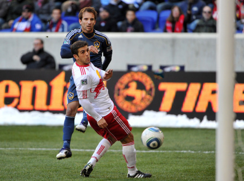 thebeautyofsports:  Mike Magee #18 of the Los Angeles Galaxy takes a shot on goal past Carlos Mendes #44 of the New York Red Bulls that resulted in the only goal of the game during the first half at Red Bull Arena on October 30, 2011 in Harrison, New Jersey. The Galaxy defeated the Red Bulls 1-0. (Photo by Christopher Pasatieri) (via Yahoo! Sports Photos)
