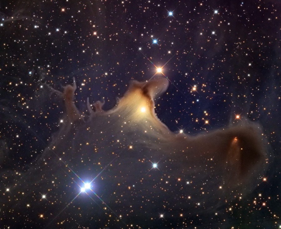 Ghost of the Cepheus Flare Explanation: Spooky shapes seem to haunt this starry expanse, drifting through the night in the royal constellation Cepheus. Of course, the shapes are cosmic dust clouds faintly visible in dimly reflected starlight. Far from your own neighborhood on planet Earth, they lurk at the edge of the Cepheus Flare molecular cloud complex some 1,200 light-years away. Over 2 light-years across the ghostly nebula and relatively isolated Bok globule, also known as vdB 141 or Sh2-136, is near the center of the field. The core of the dark cloud on the right is collapsing and is likely a binary star system in the early stages of formation. Even so, if the spooky shapes could talk, they might well wish you a happy Halloween. Image Credit & Copyright: Adam Block, Mt. Lemmon SkyCenter, University of Arizona