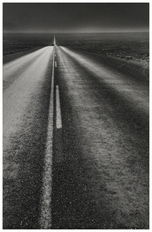 "liquidnight:  Robert Frank U.S. 285, New Mexico, 1955 Frank asked Jack Kerouac to write the introduction to The Americans. Of this photograph, Kerouac wrote: ""Long shot of night road arrowing forlorn into immensities and flat of impossible-to-believe America in New Mexico under the prisoner's moon."" [via billyjane * via The New Yorker]"