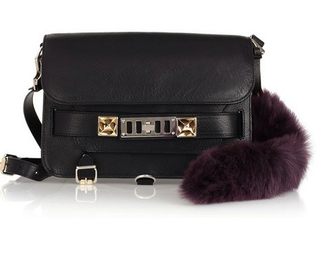 Love these shearling bag charms by Karl Donoghue - they come in teal, ruby and magenta. A good alternative to a fox tail, if fur isn't for you! Ruby bag charm, $75, netaporter.com