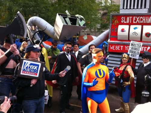 ryanbrown:  john:  Halloween meets Occupy Wall Street (Not) Fox News covers Unemployment Man  I need to see more of these!  Coming right up.