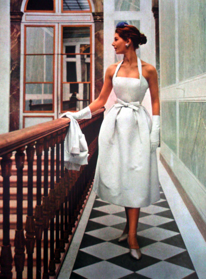 theniftyfifties:  Model wearing a white summer cocktail dress for Vogue Paris, 1952.
