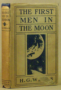 "The First Men in the Moon H.G. Wells.  Indianapolis: The Bowen-Merrill Company, 1901.  title page printed in black and red, original pictorial navy blue cloth, front panel stamped in gold and blind, spine panel stamped in gold.. Early owner's name and date (""Xmas, 1908"") in ink on front free. endpaper, a truly fine copy with brilliant cover stamping in the. original first state pictorial dust jacket (printed in dark blue on. buff paper stock) with ""Bowen / Merrill"" imprint at base of spine. panel. The dust jacket has shallow chips from crown and tail of spine. panel (no lettering affected), some shelf wear at corner tips, and a. scrape to the surface of the front panel along the lower edge which. affects ""ELL"" of ""WELLS"" and extends up slightly into the lower blue. background of the illustration. Still an attractive example of a rare. jacket. Although book and jacket are mixed states, they have not been. married (there is faint ghosting from the flap copy of this jacket on. the fore-edges of the free endpapers); we surmise the book was. distributed with this jacket by the publisher who changed their name. from Bowen-Merrill to Bobbs-Merrill in January 1903, some 15 months. after the book was published in late September or early October 1901. (it was listed Publisher's Weekly 5 October 1901). The size of the. edition is not known, but the book was apparently not a big success. and unsold sheets of the first printing were later sold to Grosset &. Dunlap. This is the second known copy of this edition in the original. jacket. (#9451). First edition, second state binding with ""Bobbs / Merrill"" at base of spine panel. Preceded the British edition by approximately one month. The two editions have minor textual differences. ""… a gripping adventure story as well as a historic milestone in modern science fiction."" - Survey of Science Fiction Literature II, pp. 782-86. ""The last and most complex [of Wells's early scientific romances] is THE FIRST MEN IN THE MOON."