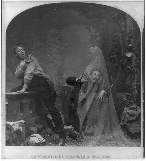 "Image description: This photo, circa 1889, shows a ghost scaring two men. From the mid-1800s to early-1900s, ""spirit photographs"" were popular and easy to fake. Learn more about spirit photographs. Photo from the Library of Congress Prints and Photographs Division"