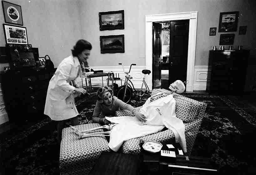 ourpresidents:  Betty Ford scares up the President's chair- Here's a glimpse of White House Halloween antics from 1974.  Betty Ford and her personal assistant, Nancy Howe, dress a skeleton in President Ford's study.  -from the Ford Library