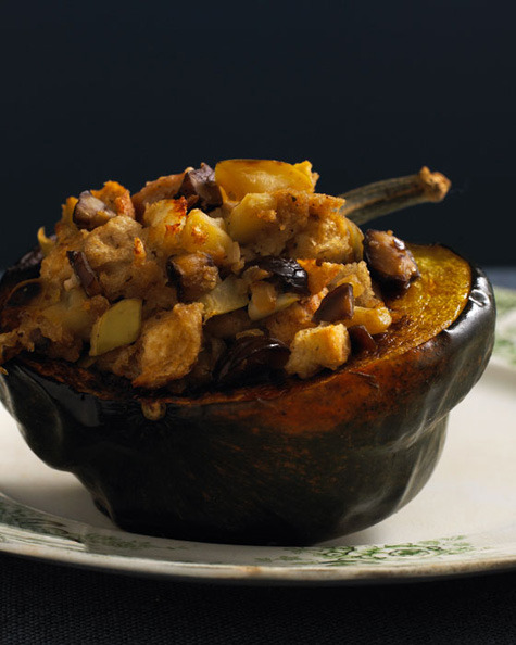 "Acorn Squash with Apple Chestnut Stuffing  this looks incredible, but also like a lot of work. bookmarking for future ambitious cooking. Ingredient: 2 acorn squashes  4 cups of 1/2-inch cubed, day-old sourdough or rustic bread  1 cup vegetable stock  10–12 chestnuts roasted and roughly chopped  1 green apple diced  6 fresh sage leaves chopped  2 tbs. olive oil  1 tsp. brown sugar  1 small diced onion salt and pepper to taste  Directions Preheat oven to 450 degrees.  Split  acorn squash in half vertically and deseed. Coat the inside cavities  with 1 tablespoon of olive oil and sprinkle with salt. Place the squash  face down on a baking sheet and put them in the oven for about 20  minutes or until easily pierced with a knife. You can prepare  the chestnuts at the same time as the squash. Mark an ""X"" on the flat  side of each chestnut with a sharp knife. Place the chestnuts on a  baking sheet with the ""X"" facing up and add them to the oven for 20  minutes. Remove from the oven and let them cool. After the chestnuts  have cooled, peel them and give them a rough chop.  After removing chestnuts and acorn squash from the oven, lower temperature to 350 degrees.  In  a pan, add the rest of the olive oil, diced onion and salt. Cook onions  until slightly brown. Add the diced apple and cook until tender. Then  add the brown sugar and mix until combined, being careful not to let the  sugar burn. Add the chestnuts and heat through then add the vegetable  stock and cook for 2 minutes until everything is nice and hot.  In  a large bowl, combine your cooked mixture with the cubed bread. Mix  gently until all the bread has absorbed the liquid. Generously salt the  acorn squash then spoon the stuffing into the acorn squash halves.  Return them to the oven for 20 minutes or until heated through and the  tops are a bit crispy. Serve and enjoy. (via in the kitchen with: william brinson 