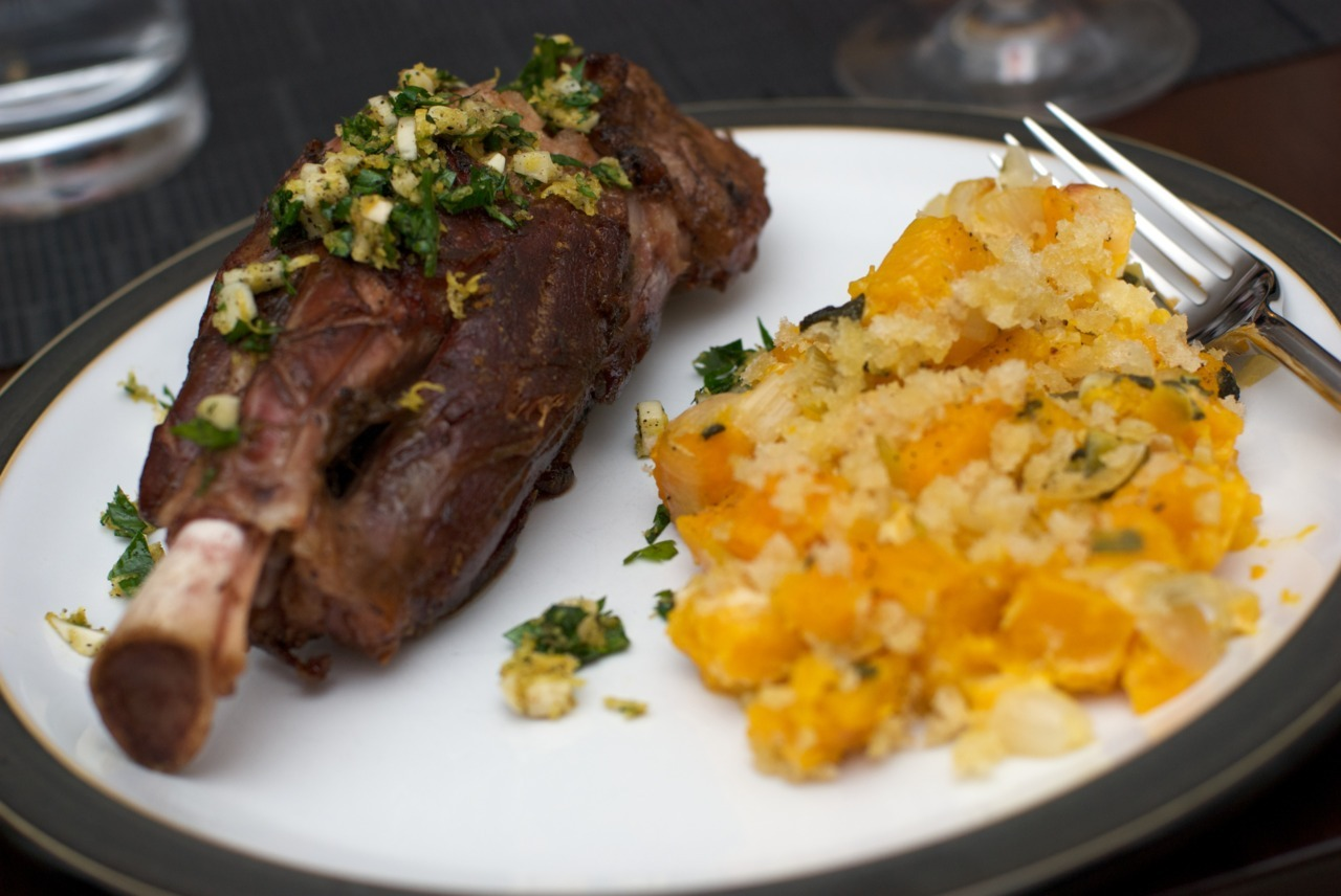 jpeats:     Slow cooked lamb shank with gremolata and butternut squash gratin. These lamb shanks were the first in what I'm sure will be a long line of tests to find the best way to cook them sous vide. Last week's 72-hour short ribs made it clear that very low temperatures and very long cook times could do wonders for these tougher, more flavorful cuts. The problem is, most of the recipes online tell you to cook lamb shanks at 180 for some number of hours. At that temperature, what's the point? I want to use sous vide to make sure these babies come out medium rare and tender, not just super tender. But, lamb shanks also have all kinds of connective tissue that only just begins to break down at 140 degrees. So, that's where I started with my first test—a 140 degree water bath for 48 hours, with nothing other than salt and pepper. A quick sear at the end leaves the shanks looking like you see in the picture above. The results are delicious, but not quite right yet. On the plus side, the flavor is incredible. Braised shanks will never have such a deep lamb flavor or be cooked to a perfect medium rare like these are. But, at this temperature and duration, too much of the connective tissue remained in tact. It was fine and didn't detract too much from the experience, but I would never serve them to guests that way. The plans for future testing include extending the time to 72 hours, raising the temperature a degree or two, and adding fat to the bag to essentially turn the process into confit.
