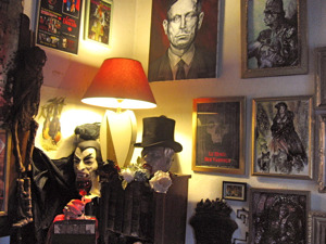 "The Vampire Museum The Musée des Vampires is a small private museum (near the Mairie des Lilas) dedicated to vampires and the study of their place in folklore and modern culture. Located just on the outer edge of Paris, it can be a bit complicated to visit for non-French speakers, but it's totally do-able and absolutely worth the effort if you're a fan of vampires, mythology, and weird stuff in general! When I was initially researching the museum, all of the sources I found online, most of which are in French only, mention that the museum is open daily from 12:30pm to 8pm, but some sites don't make it perfectly clear that you must have an appointment to visit. Making an appointment is little complicated if you don't speak French, as the main phone number listed (01 43 62 80 76) just gives you a recorded message in French. This message lists the hours and also gives a cell phone number — 06 20 12 28 32 — which you can call to make an appointment. The museum's curator, a wonderful, captivating fellow named Jacques Sirgent, speaks impeccable English. So if youdon't speak French, try calling the cell number and very politely asking, ""Parlez vous anglais, s'il vous plait?"" and I'm sure Monsieur Sirgent will be happy to help you. The collection: You enter the museum through a small courtyard at the back of a private residence. The main room that was open to the public when I was there was a crowded, cluttered, and absolutely fascinating collection of every type of vampire-related item you can imagine: stacks and stacks (and stacks) of books, dozens of paintings and movie posters lining the walls, spooky fine art objects, Halloween-esque props, et cetera, et cetera — even a mummified cat found in Père Lachaise Cemetery! The room is relatively small but I could've spent all day in there inspecting these treasures. One highlight I found very impressive: the autographs of every actor who's ever starred as Dracula in a Hollywood movie! After briefly being shown around the place by Monsieur Sirgent, we sat down for a long chat about the history of vampires, their folkloric origins, and their place in French history and the modern human psyche. Monsieur Sirgent, or Jacques as he told us to call him, has written several books on the topic, and very clearly is an expert on all things vampiric. Beforehand, I was a little concerned we'd find the museum's director to be sort of overly goth or flaky or downright crazy, but I'm pleased to report Jacques is actually almost startlingly down to earth, and completely, well, normal! I made a joke about having worried that he'd be a serial killer, and he laughed and immediately pointed out a painting on a wall and told me it had been painted by famous French murderer Nicolas Claux, ""le Vampire de Paris,"" with whom Jacques is acquainted. Wow.  Via Cool Stuff in Paris, click the photo to read more!"