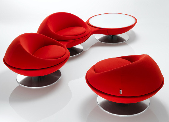 The 123 ultra modern rotating armchairs, made by French design firm Steiner, give your seating arrangement a twist on the ordinary. Bright red cups of comfort, these modern armchairs sit on stainless steel pedestals and come separately or joined in sets of 2 or 3 and are connected at arm level.