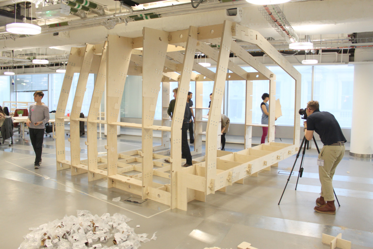 The first part of the WikiHouse London prototype (and a new meeting room for HUB Westminster) being assembled during the Changemakers Fayre.
