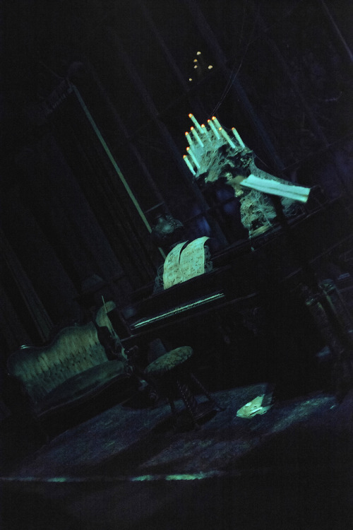 Did you know? The eerie piano in the Haunted Mansion that  is apparently playing by itself is actually being played by a ghost  whose shadow you can see by looking at the floor in front of it. There  are also 3 sheets of music but one is scattered on the floor and only contains  staff lines implying that the composer never lived to complete his work and  is doomed to haunt the mansion until it is finished. The piano itself is  an original by Schomacker Piano Co. built somewhere between 1870 and  1890.