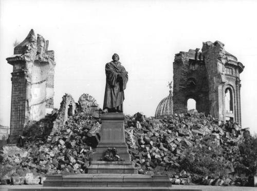 A statue of Martin Luther in front of the Dresden Frauenkirche (Church of Our Lady) in 1958, thirteen years after its destruction during the bombing of Dresden. The church lay dormant in ruins for decades. After more than a decade of rebuilding it was finally reconsecrated on October 30, 2005. Legend also states Martin Luther pinned his 95 theses to the door of the All Saints' Church in Wittenberg on October 31, 1517 - 494 years ago today.