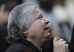 A Christian woman weeps during a mass at Our Lady of Salvation church in #Baghdad, #Iraq, Monday, Oct. 31, 2011. Iraqi Christians have gathered for mass one year after church was the scene of a horrific attack that left scores dead and wounded. (AP Photo/Hadi Mizban)