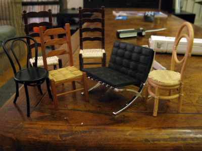 These are some of my miniature chairs before I wrapped them up. They went downtown last night. I'm just posting this in case anyone ever needs to buy me a present and isn't sure what to get. You can give me a miniature chair. Any kind. Anytime. Even if it's not my birthday or Christmas or whatever and you just felt like buying me a gift. I will always accept mini chairs. I'm good on rush seat ladderbacks though. Just FYI. That is all, carry on.