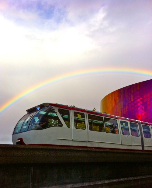Rainbow over Seattle Center Monorail and EMP Museum. Love my job. Photo by Megan Ching.