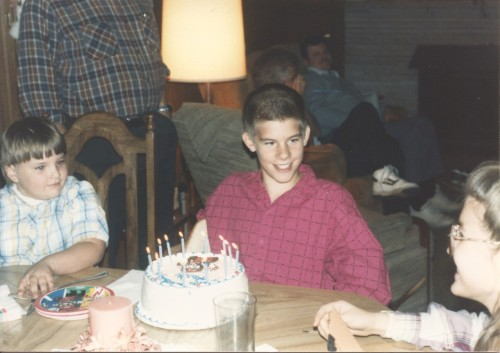 21 years ago today. Mario cake & fuchsia shirt, yup its 1990.