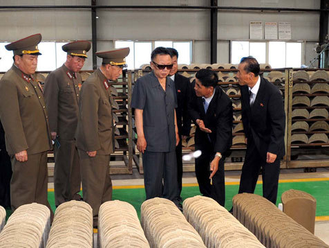 kimjongillookingatthings:  looking at tiles  Kim Jong-Il looking at things organized neatly.