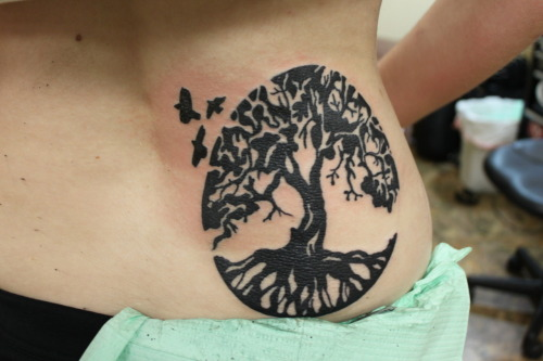 I love trees. I knew that for my second tattoo I wanted a tree. My Brother was getting ready to deploy for Afghanistan, and before he left I wanted to get a tattoo with him. I wanted him to be there, holding my hand. The three birds represent me, my brother Travis, and my Brother Casey. We have grown up together, we have always been together..and I have had the hardest time growing up, and having them leave me. This tattoo is a tribute to us, to our life. We may fly away sometimes..but we will always come back to our tree, our home..and be together.
