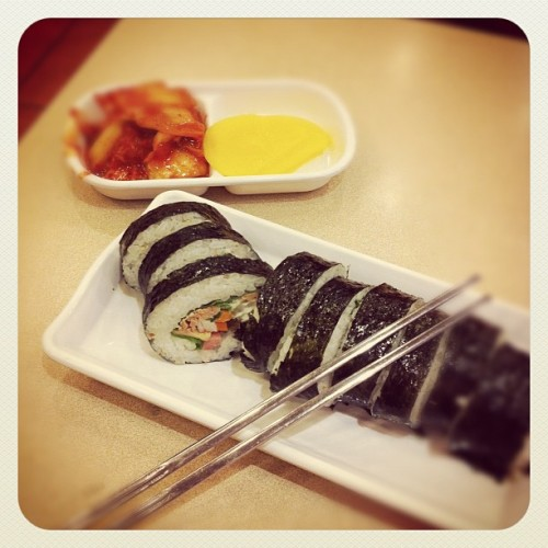 So, this is Kimbap.  I would describe it as the Korean version of a sandwich.  Not in flavor, but in accessibility and convenience.  It's everywhere.  Here's an easy recipe if you're interested in making it, or if you just want to check out what the ingredients are like you can see them here as well: http://koreanfood.about.com/od/riceandnoodlerecipes/r/kimbap.htm The one in the picture is Tuna Kimbap, of JamJi Kimbap in Korea.  I would describe it as infinitely better than normal Kimbap…mostly because there's mayonnaise in it.  Right now, I love smothering it in sweet sweet spicy Kimchi.