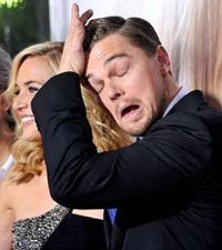 Lacking a proper Halloween costume, Leonardo DiCaprio does his best to make his face look like the mask from the Scream series. ((Hope everybody had a great Halloween! -M ))