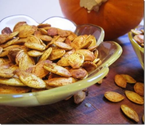 Coconut Curry Roasted Pumpkin Seeds— mmhm delicious fall snack. and coconut oil is good for you!   Ingredients 2 cups raw pumpkin seeds 1 tablespoon coconut oil 1 1/2 teaspoon curry powder 1/2 teaspoon turmeric 1/2 teaspoon coriander 1/4 kosher salt Directions Preheat oven to 350 degrees. Combine coconut oil and seeds in a large bowl.  Sprinkle the curry, salt, turmeric and coriander over the seeds and toss to coat seeds in seasoning. Pour onto a baking sheet. Bake for 45 minutes or until golden brown.