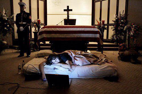 "painesofglass:  The night before the burial of her husband 2nd Lt. James Cathey of the  United States Marine Corps, killed in Iraq, Katherine Cathey refused to  leave the casket, asking to sleep next to his body for the last time.  The Marines made a bed for her, tucking in the sheets below the flag.  Before she fell asleep, she opened her laptop computer and played songs  that reminded her of ""Cat"", and one of the Marines asked if she wanted  them to continue standing watch as she slept. ""I think it would be kind of nice if you kept doing it"" she said. ""I think that's what he would have wanted"". -Not sure what is more honorable: Being married to this faithful wife  to the end or the Marine standing next to the casket watching over them  both."
