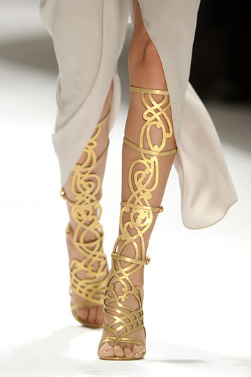 Details: Elie Tahari Spring 2012 RTW shoephoric:  Gold cut-out knee high boots suitable for a Goddess!