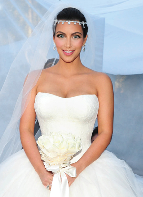 Kim Kardashian in a wedding dress with Michele Bachmann eyes.