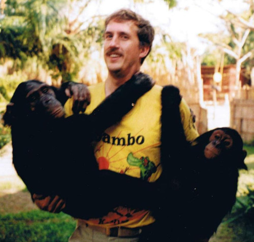 """This was taken at the Jane Goodall Chimp Sanctuary in Bujumbura, Burundi. While I was living in Bujumbura on the weekends I used to volunteer at the sanctuary to help feed and play with the chimps. Aly, the chimp in my right arm was one of my favorites and she because a poster child for their fund raising."" - Peace Corps Education Volunteer 	Mike Junge"