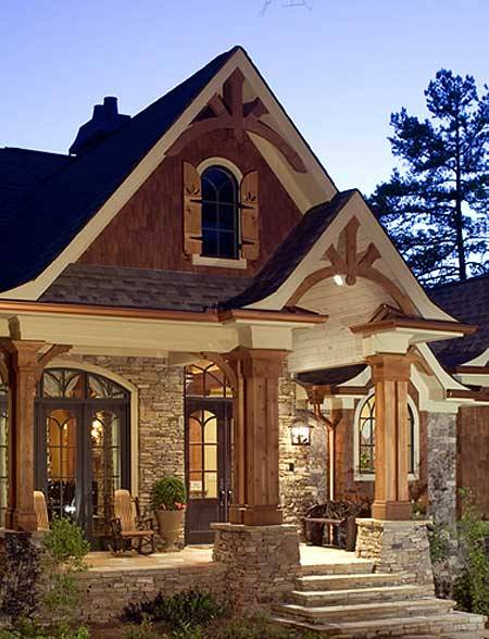 Entry to a wood and stone house that displays Craftsman details (via Plan W15651GE: Corner Lot, Luxury, Mountain, Photo Gallery, Craftsman, Vacation, Premium Collection House Plans & Home Designs)