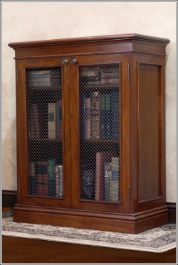 A hand-crafted, solid mahogany and brass bookcase. To purchase or customize this bookcase, please visit our website: Custom Mahogany Bookcase