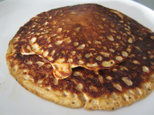 sarahfit:  Apple Cinnamon Oatmeal Pancakes  Makes: 2 servings Prep Time: 30 minutes (or overnight) Cooking Time: 6 minutes Ingredients: 1/4 cup of Rolled Oats 1 small Apple (chopped finely) 1/2 tbsp Chia Seeds 1 tsp Cinnamon 5 drops of liquid stevia like NuNaturals (you may also use a packet of stevia, sugar or other sweetener) *optional 2 cups Water 3 tbsp Egg Whites (or 2 Egg Whites or 1 Egg plus 1 Egg White) 1 scoop Vanilla Whey Protein Powder Directions: I made my oatmeal using my rice cooker by combining the first 5  ingredients and stirring occasionally for about 2 hours.  I did this  after dinner and unplugged it right before bed.  You can also boil the  water, add in the oats, apple, chia, cinnamon and stevia and simmer for  20 -30 minutes or until water is absorbed.  This is too much water but  the oats will expand and chia seed will soak it up too.  This is why it's fun to make the oatmeal the night before.  Add in 1/2  cup of the apple cinnamon oatmeal to a bowl combining with the egg  whites and protein powder.  Blend with an immersion blender, blender or  fork.  Spray a pre-heated pan on medium and add mixture. Once the bottom is settled and easy to flip, turn and cook for another  2-3 minutes.  Serve with maple syrup, heated peanut butter, extra  oatmeal, Greek yogurt or plain if you're like me.  Below is a typical  breakfast for me: Protein pancake with a 1/2 grapefruit, water and  coffee! YUM!