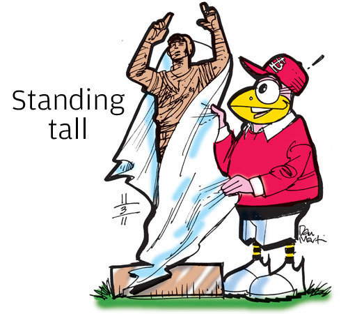 Standing tall • Just six days after the St. Louis Cardinals won the World Series, and just a few days into Albert Pujols' new status as a free agent, a 10-foot tall bronze statue of the slugger was unveiled outside Pujols 5 restaurant in West Port Plaza. The statue shows Pujols crossing home plate, eyes skyward and arms pointing up, his trademark pose after a home run.