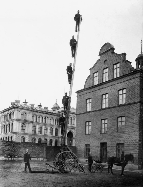 ckck:  Firemen on a ladder. Sundsvall, Sweden, early 1900s.
