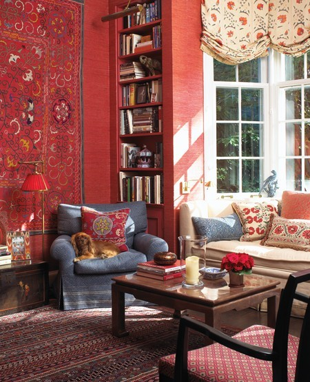 Boldly hued grass-cloth wallpaper, a Turkish rug, comfortable seating and rich patterns invite homeowners and guests to curl up with a good book in this Bohemian style library (via Vote For Your All-Time Favourite H&H Room | House & Home)