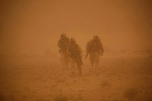 Marines caught in a sand storm during patrols somewhere in the Farah Province, Afghanistan, May 2009